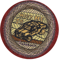 "This is an embroider of a car that looks like it was a block print, with the text ""Meet me in Anhedonia"