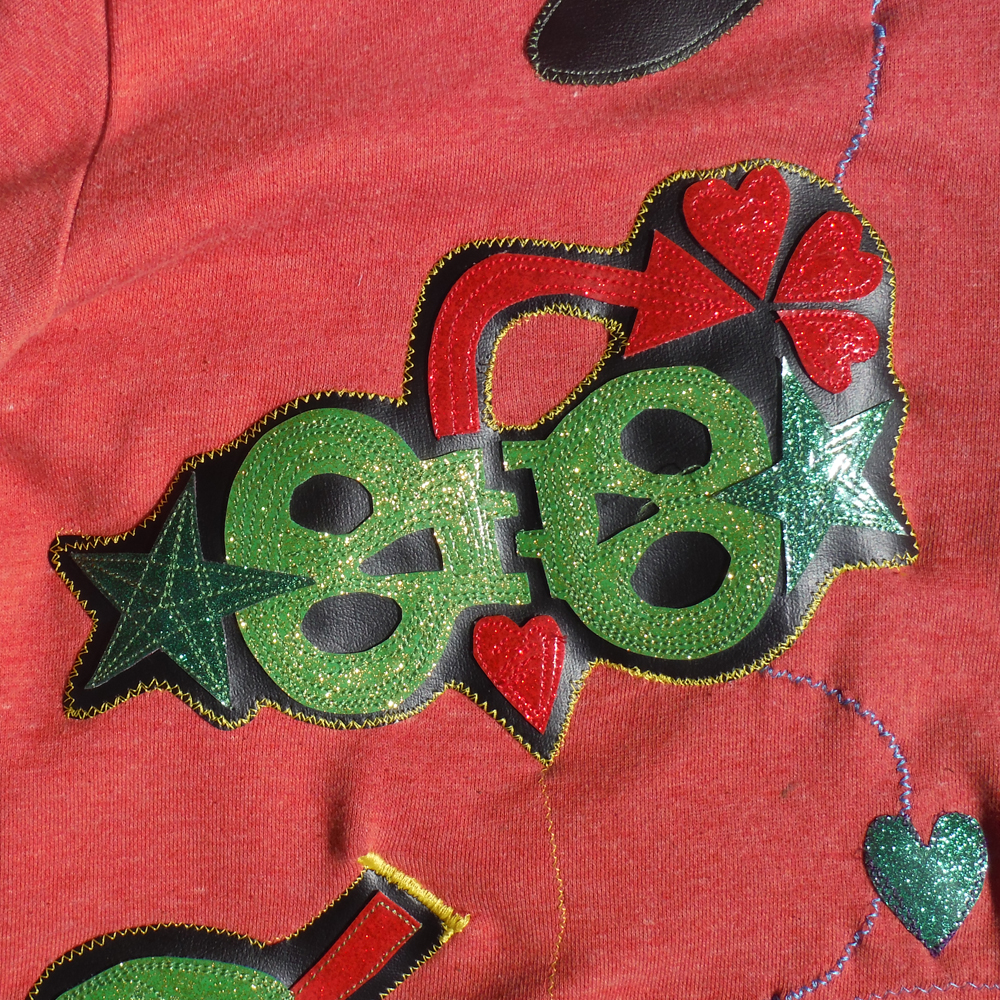 This is a another detail of a patch that could be two skulls hinged at the jaw, maybe?